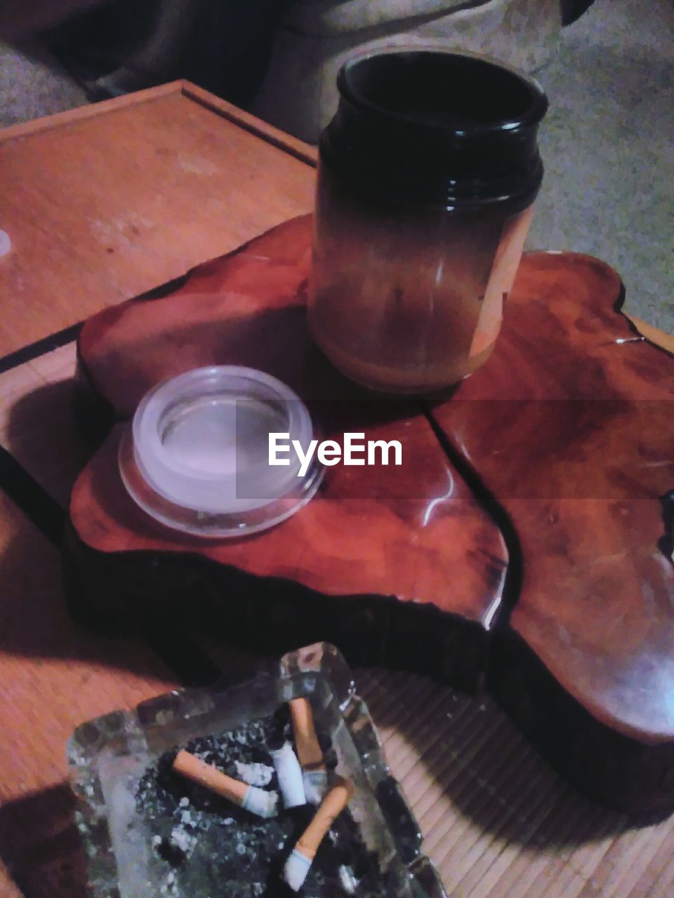table, addiction, ashtray, high angle view, bad habit, no people, drinking glass, indoors, close-up, day