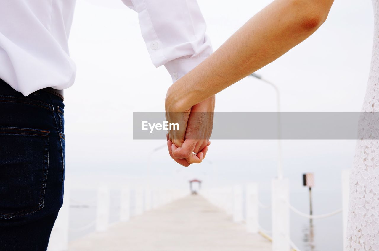 people, human body part, two people, women, love, positive emotion, midsection, adult, togetherness, hand, human hand, real people, architecture, men, opportunity, cooperation, care, occupation, outdoors, couple - relationship