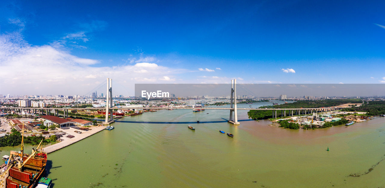 water, sky, nautical vessel, transportation, cloud - sky, architecture, built structure, building exterior, mode of transportation, city, blue, nature, no people, moored, harbor, sea, day, high angle view, waterfront, cityscape, sailboat, marina, yacht