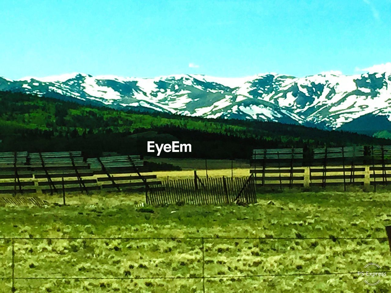 mountain, plant, tranquility, sky, beauty in nature, landscape, scenics - nature, tranquil scene, environment, land, mountain range, no people, day, grass, nature, green color, fence, field, barrier, boundary, outdoors, snowcapped mountain