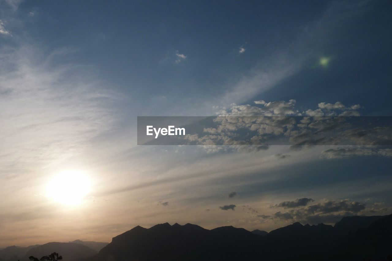 sky, beauty in nature, nature, tranquil scene, scenics, tranquility, sunbeam, majestic, sun, cloud - sky, sunset, no people, outdoors, silhouette, sunlight, low angle view, day