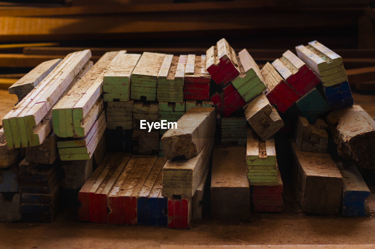 wood - material, stack, large group of objects, indoors, still life, no people, multi colored, close-up, red, abundance, wood, table, block, group of objects, toy block, side by side, arrangement, timber, education, balance