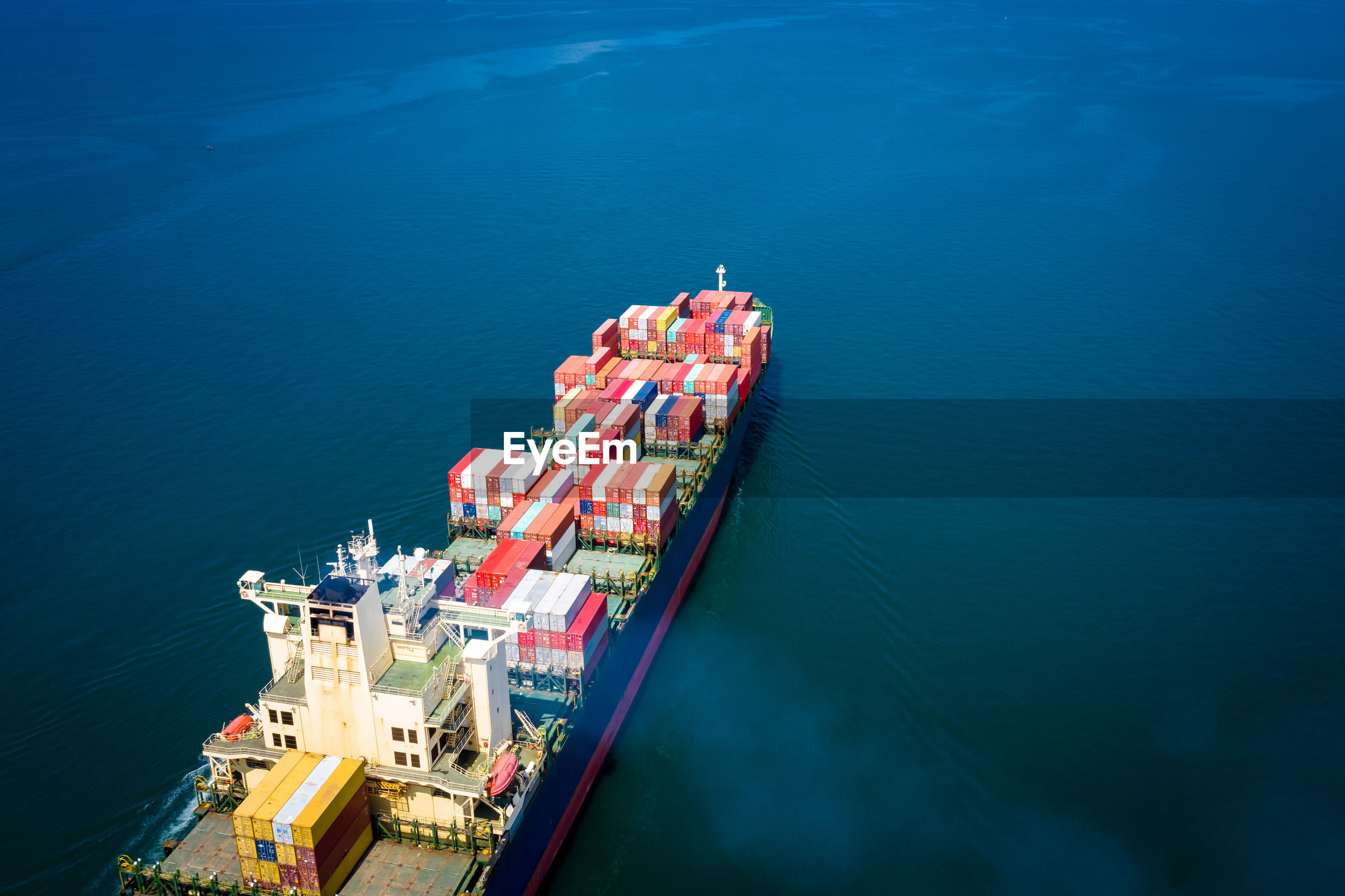 High angle view of container ship on sea
