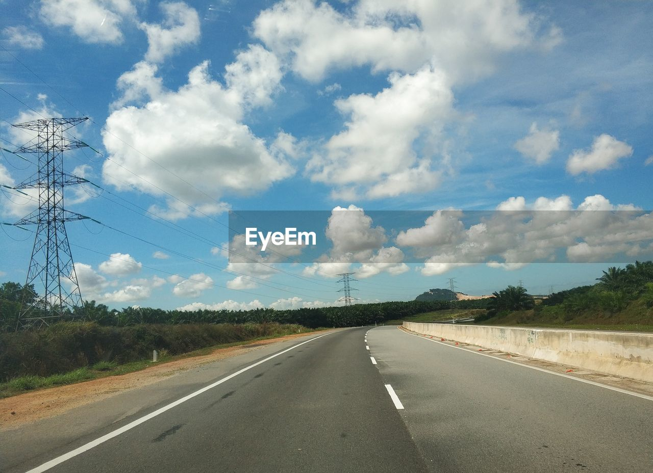 sky, road, cloud - sky, transportation, direction, the way forward, road marking, marking, day, diminishing perspective, symbol, nature, tree, sign, plant, no people, beauty in nature, vanishing point, outdoors, empty road, dividing line