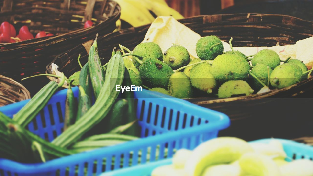 food and drink, green color, food, basket, freshness, selective focus, no people, for sale, retail, market, healthy eating, fruit, large group of objects, indoors, close-up, day