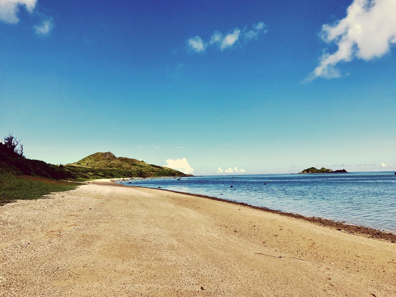 sea, beach, scenics, tranquil scene, sky, blue, sand, beauty in nature, nature, tranquility, outdoors, water, no people, day, the way forward, landscape, travel destinations, horizon over water, tree