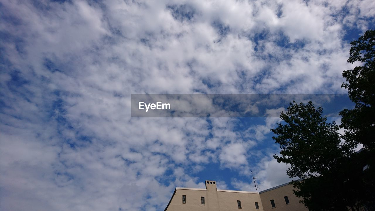 low angle view, cloud - sky, architecture, sky, built structure, building exterior, day, tree, no people, outdoors, nature, beauty in nature