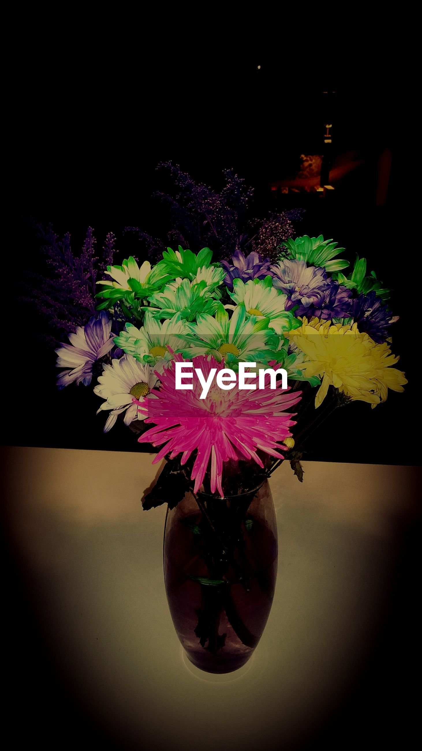 flower, fragility, freshness, petal, indoors, vase, flower head, close-up, growth, potted plant, beauty in nature, plant, decoration, nature, bunch of flowers, flower pot, pink color, table, home interior, flower arrangement