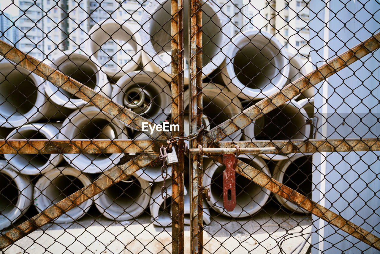 fence, chainlink fence, security, boundary, metal, barrier, safety, protection, no people, vertebrate, day, animal, focus on foreground, one animal, outdoors, full frame, close-up, backgrounds, animal themes, mammal