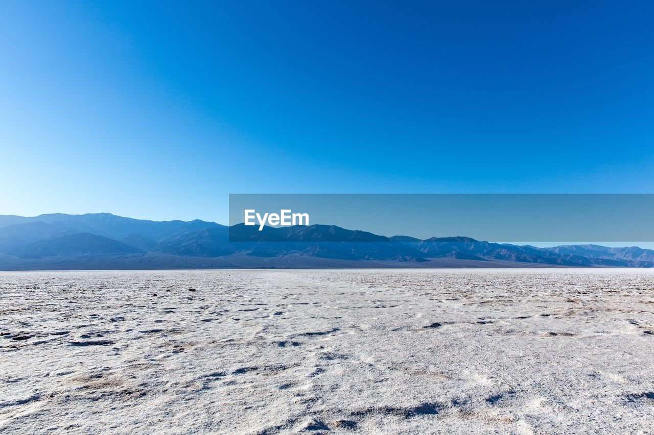scenics - nature, mountain, tranquil scene, beauty in nature, sky, blue, tranquility, environment, landscape, non-urban scene, copy space, clear sky, nature, mountain range, day, land, no people, remote, desert, idyllic, climate, arid climate, outdoors, salt flat
