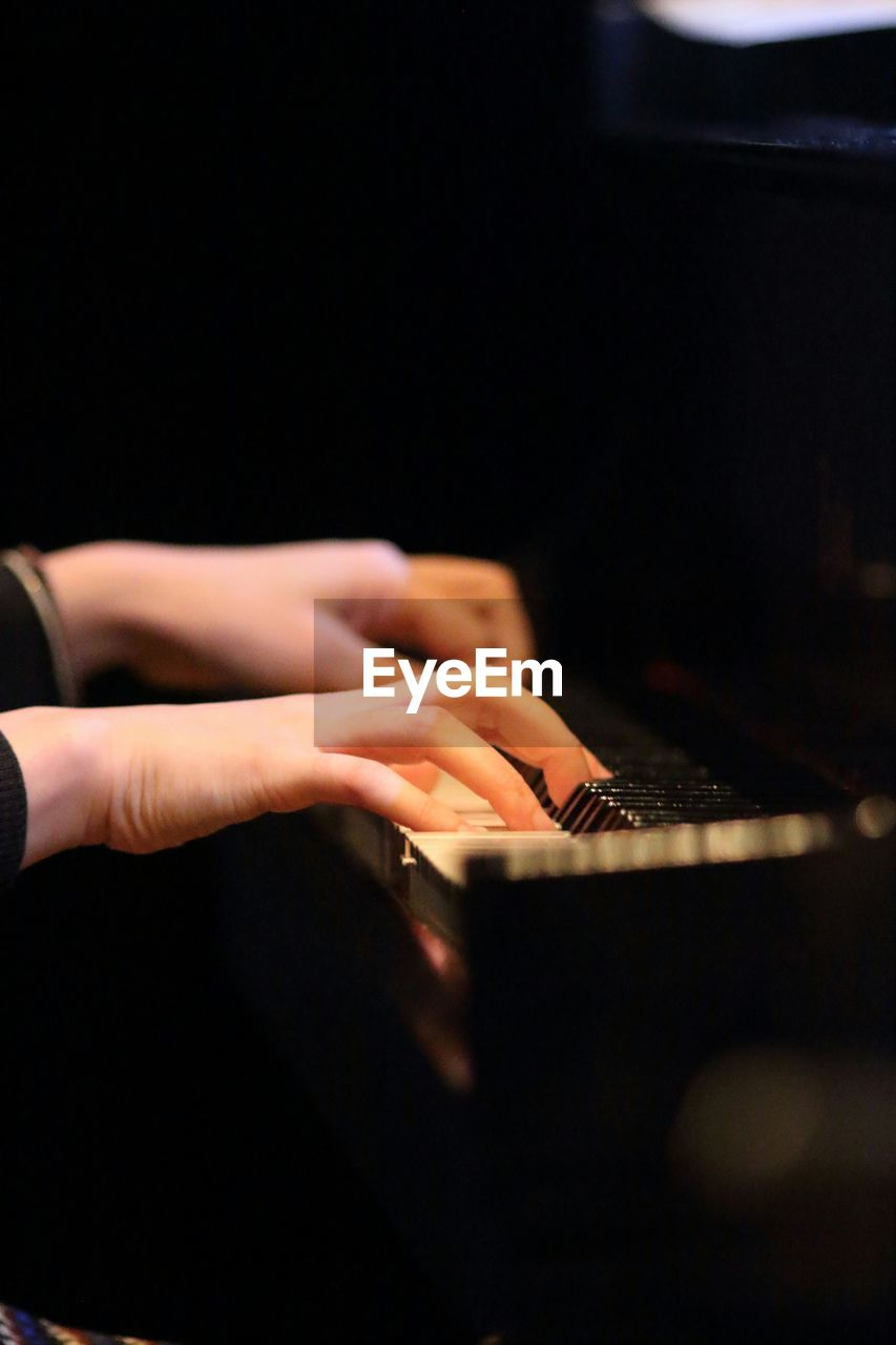 Cropped image of pianist playing piano