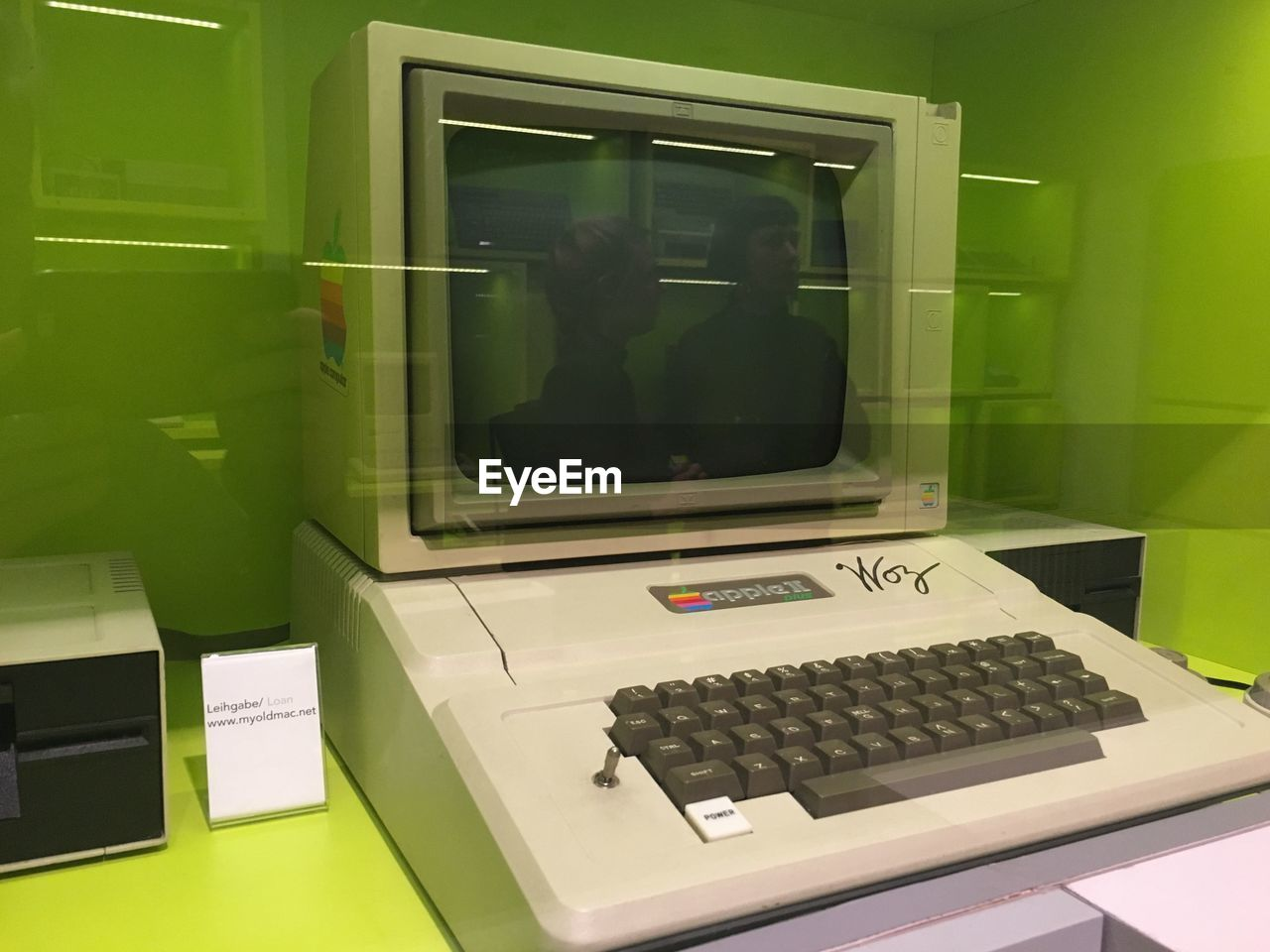 technology, indoors, glass - material, green color, reflection, communication, transparent, no people, window, table, computer, wireless technology, computer equipment, retro styled, day, furniture, connection