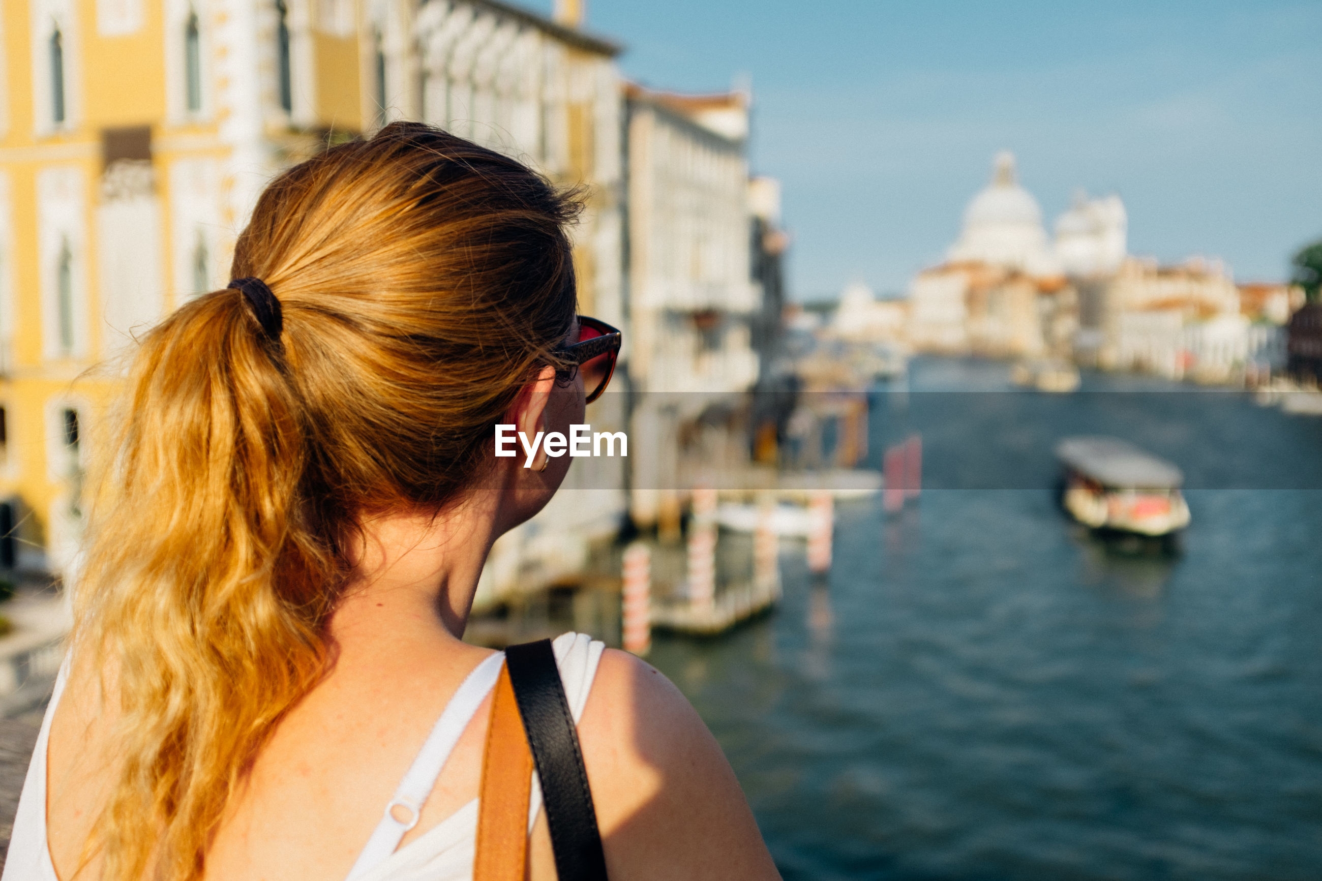 Rear view of woman looking at grand canal in city