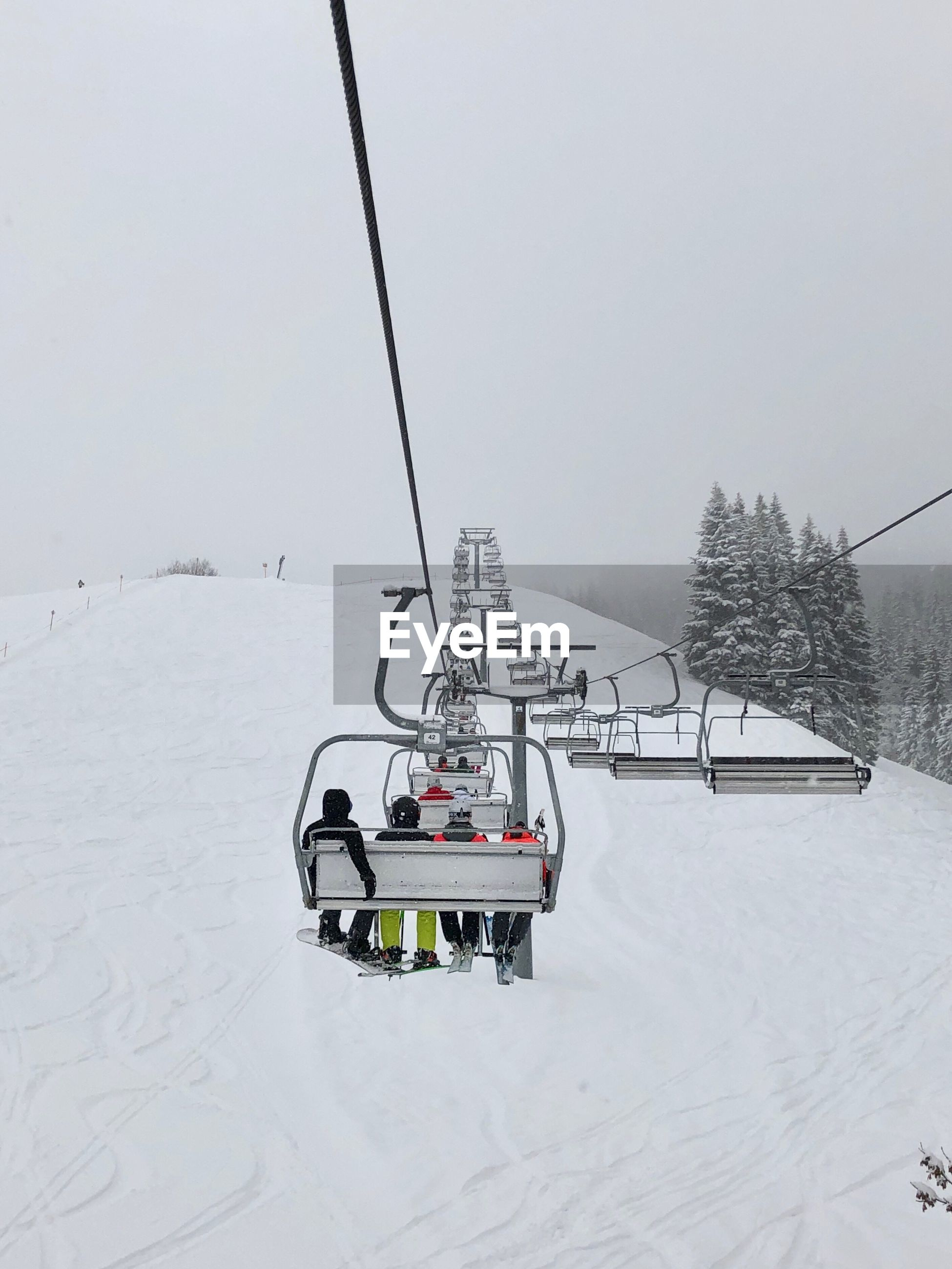 cold temperature, snow, winter, transportation, mode of transportation, beauty in nature, nature, ski lift, white color, cable car, overhead cable car, covering, day, sky, scenics - nature, land, cable, incidental people, outdoors, snowcapped mountain