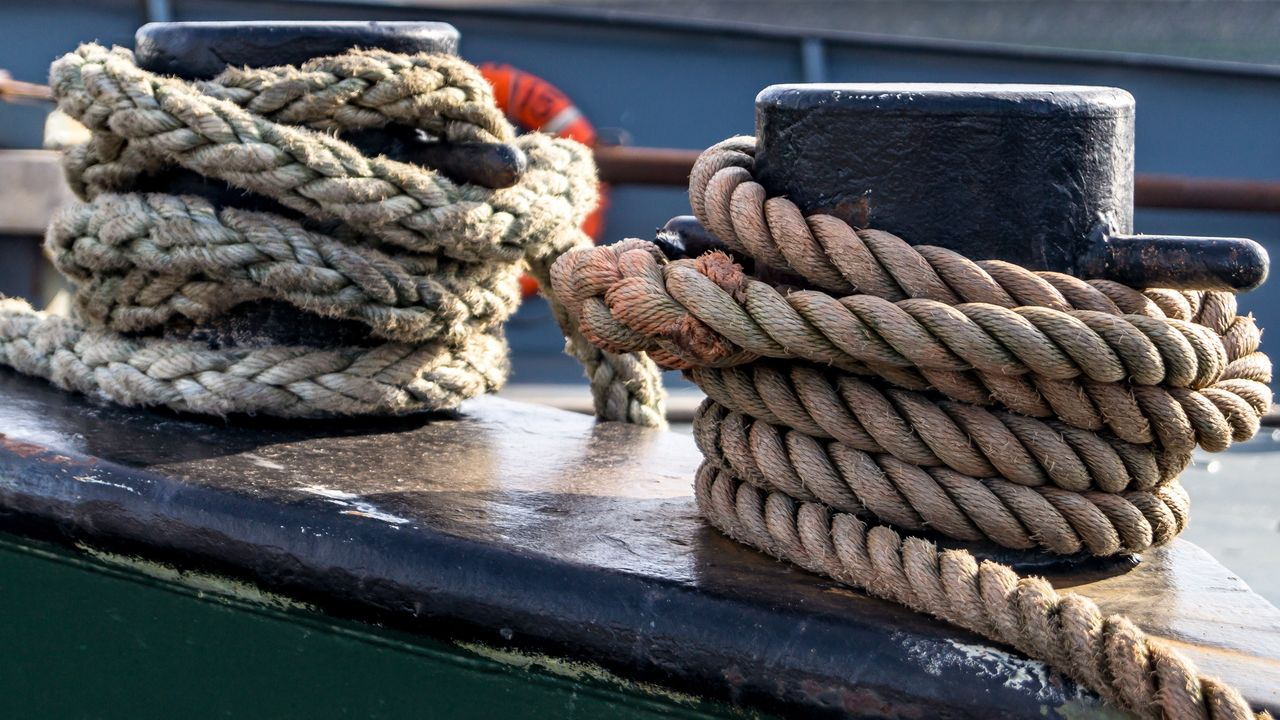 rope, tied up, close-up, strength, nautical vessel, focus on foreground, transportation, mode of transportation, no people, day, bollard, post, still life, water, tied knot, pattern, outdoors, connection, wood - material, nature
