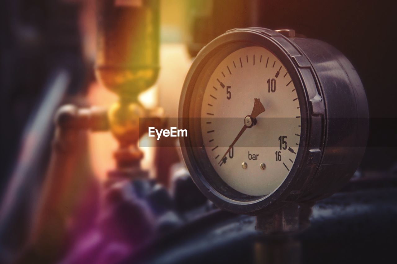close-up, time, indoors, no people, clock, selective focus, number, still life, transparent, instrument of measurement, shape, focus on foreground, glass - material, geometric shape, accuracy, gauge, circle, clock face, reflection, table