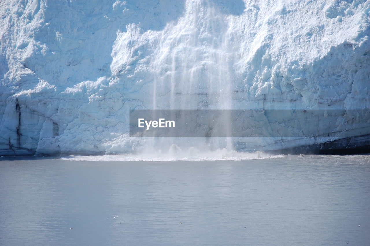 Scenic View Of Braking Ice In Water