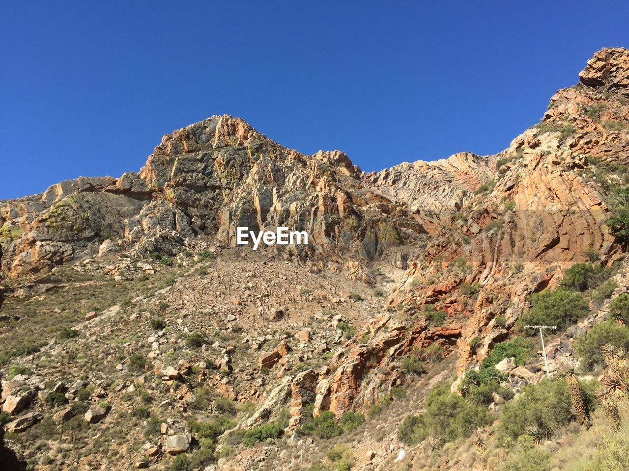 rock formation, clear sky, nature, geology, rock - object, beauty in nature, mountain, day, physical geography, tranquility, non-urban scene, scenics, outdoors, rocky mountains, tranquil scene, low angle view, cliff, landscape, blue, no people, sky