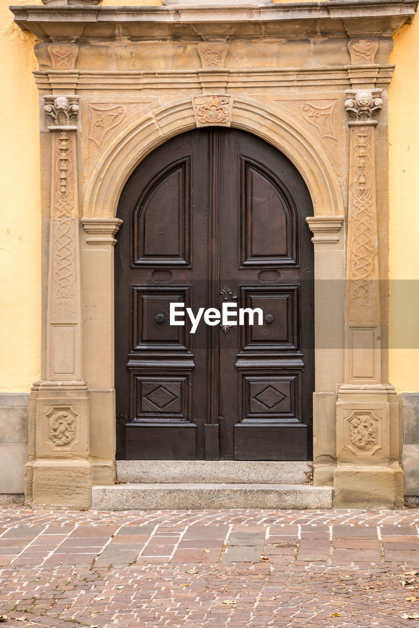 door, architecture, entrance, built structure, building exterior, closed, building, day, the past, history, arch, no people, safety, security, residential district, outdoors, protection, front door, doorway, ornate