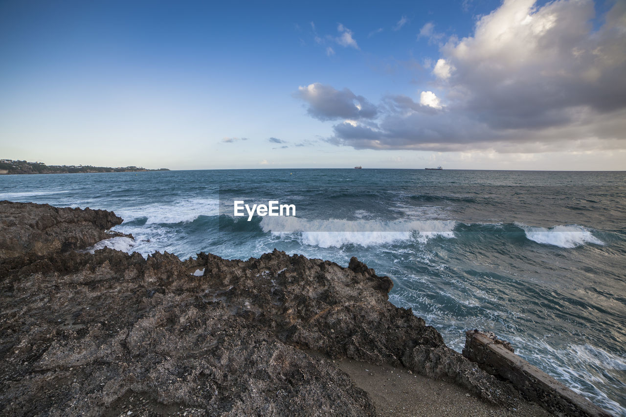 sea, water, sky, beach, scenics - nature, beauty in nature, land, horizon over water, horizon, wave, motion, cloud - sky, rock, sport, aquatic sport, rock - object, nature, no people, solid, outdoors, power in nature, rocky coastline