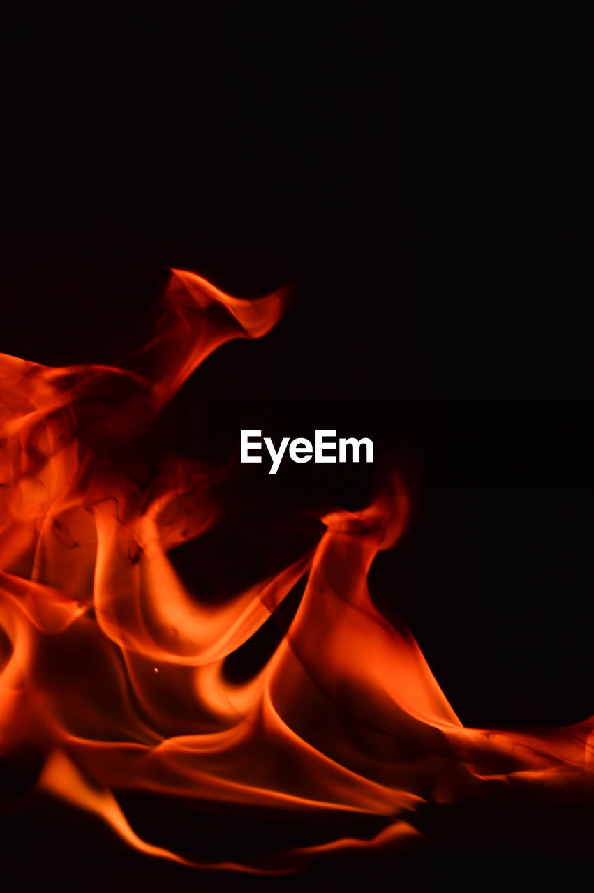 burning, heat - temperature, motion, fire, black background, fire - natural phenomenon, close-up, flame, orange color, no people, studio shot, indoors, abstract, nature, glowing, long exposure, pattern, copy space, sign, warning sign, flowing, power in nature