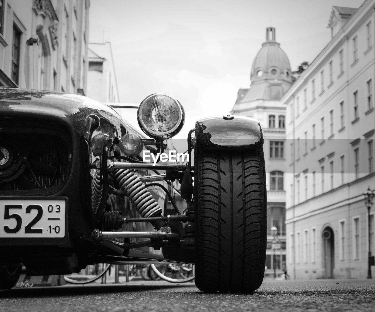 mode of transport, transportation, day, outdoors, land vehicle, building exterior, focus on foreground, built structure, car, no people, architecture, sky, close-up, city
