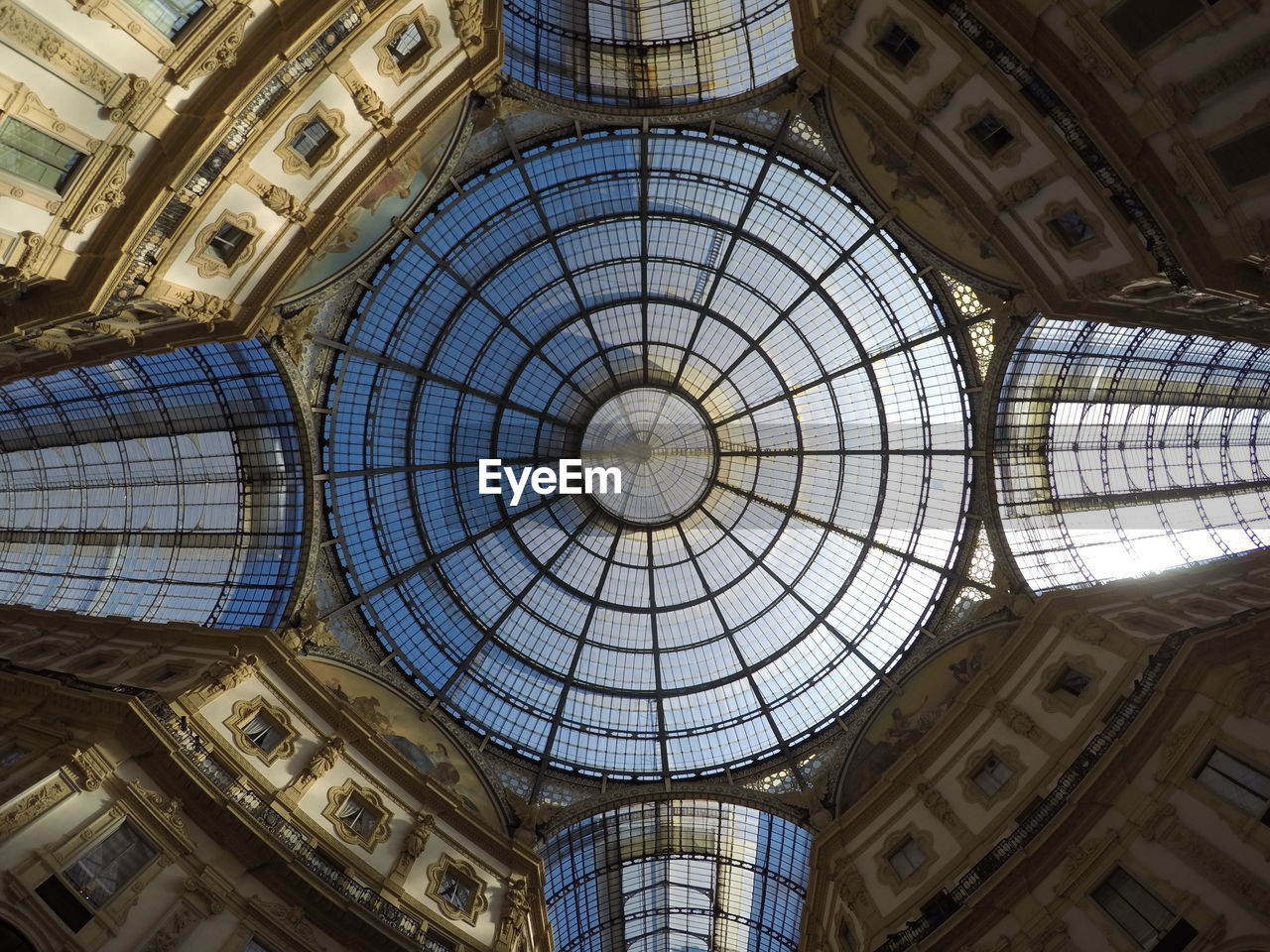 architecture, ceiling, built structure, low angle view, dome, indoors, no people, pattern, glass - material, cupola, architecture and art, history, day, travel destinations, the past, architectural feature, directly below, skylight, glass, ornate