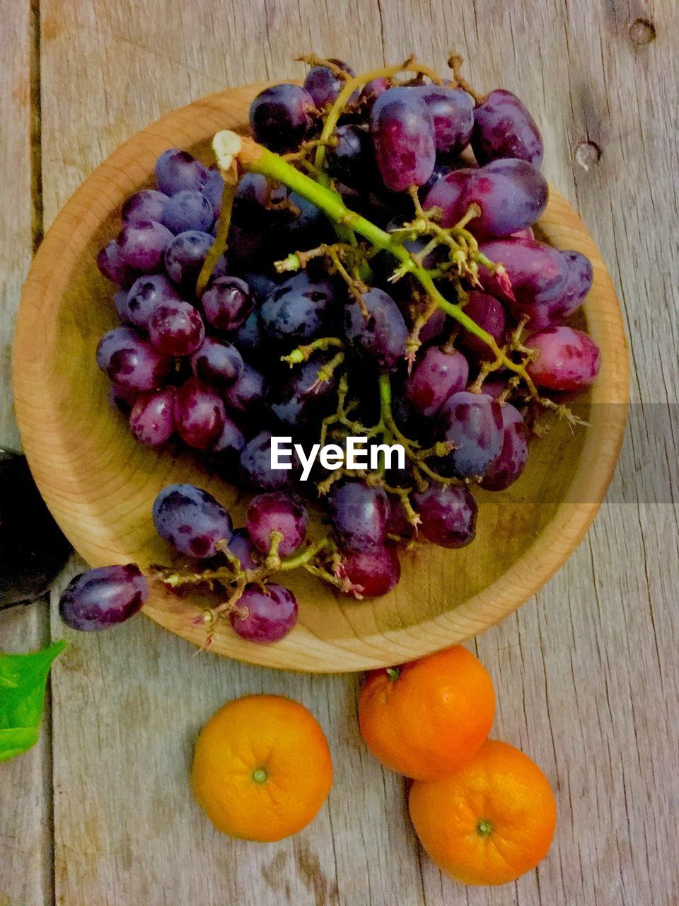 food, food and drink, healthy eating, table, freshness, wood - material, fruit, wellbeing, directly above, no people, still life, high angle view, vegetable, close-up, indoors, large group of objects, grape, cutting board, choice, variation, purple