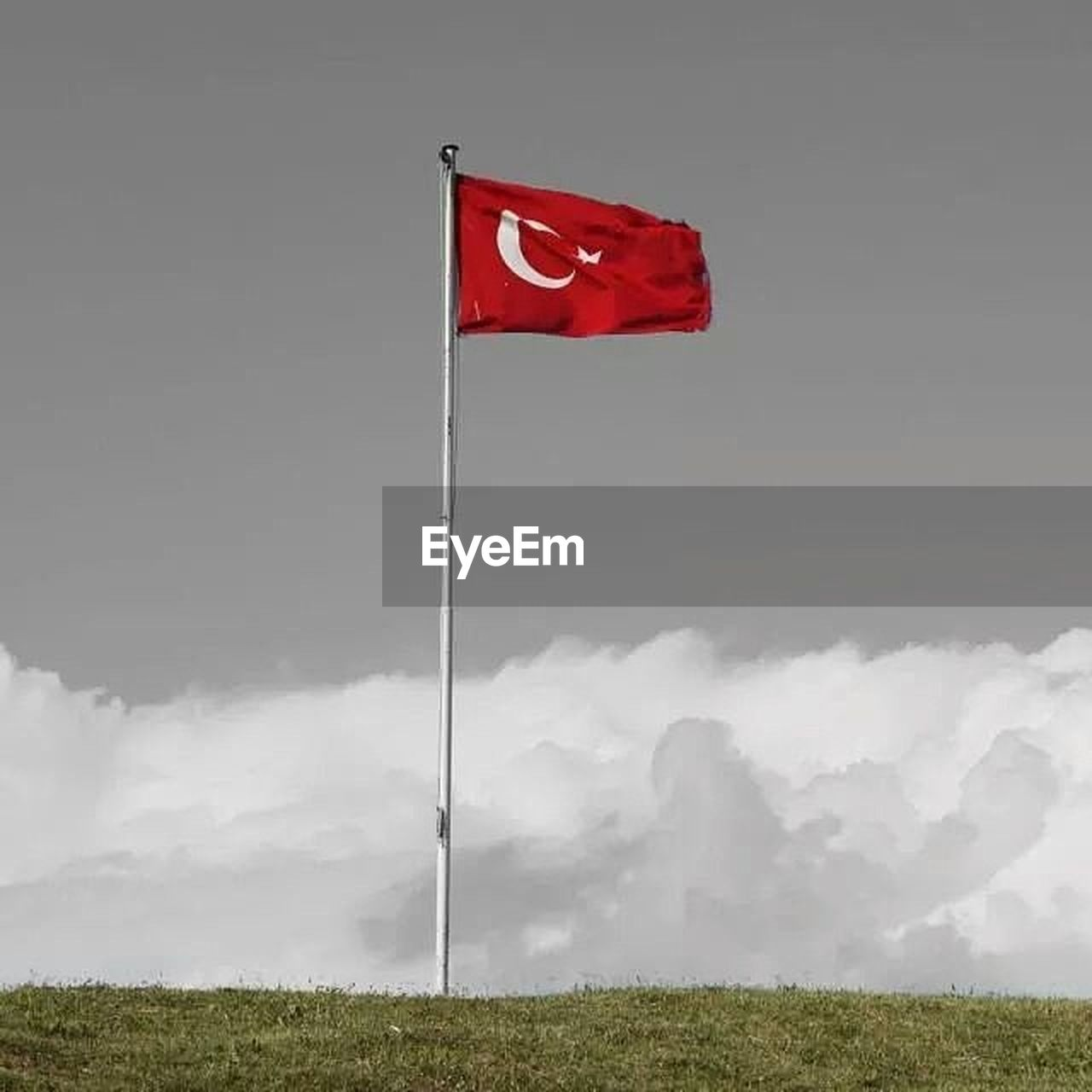flag, red, cloud - sky, wind, patriotism, outdoors, no people, day, grass, sky, nature