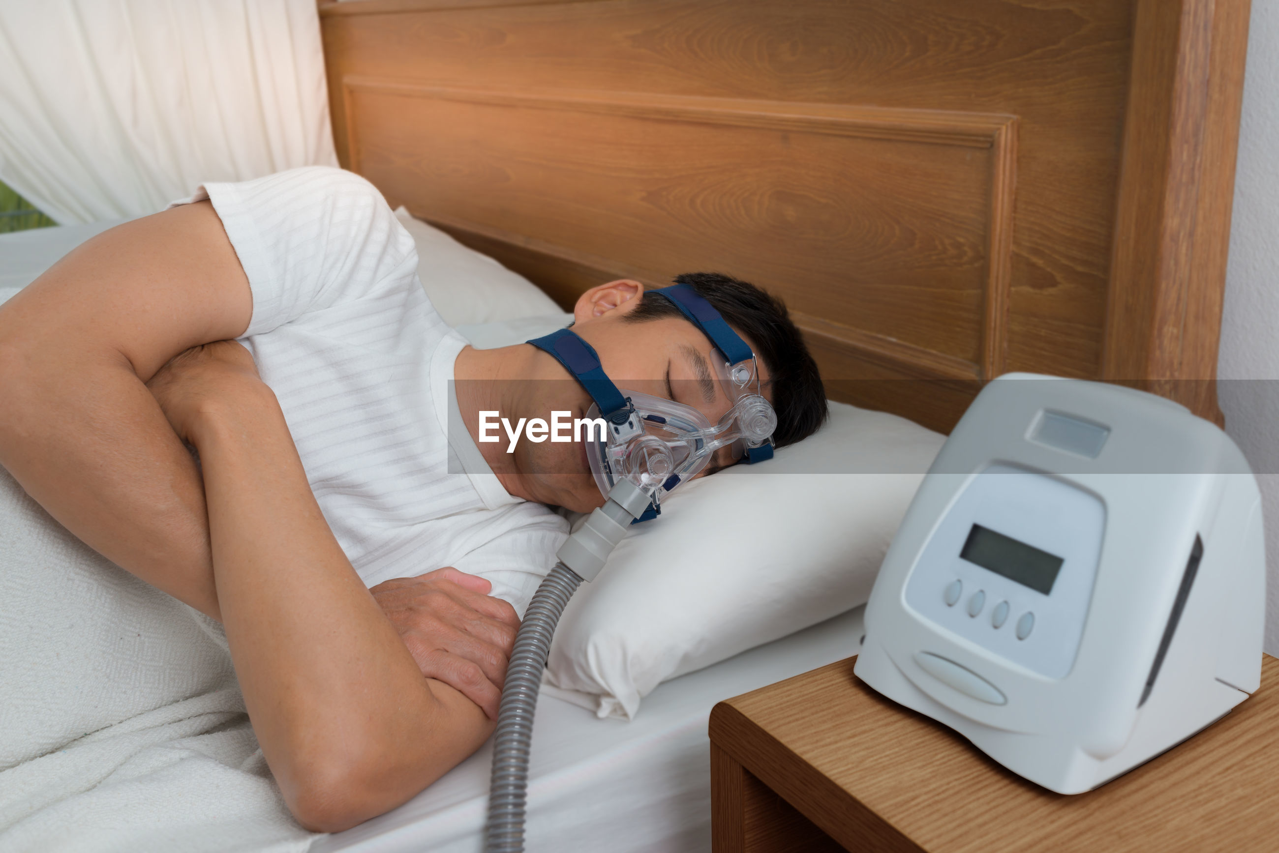 Young man taking apnea treatment