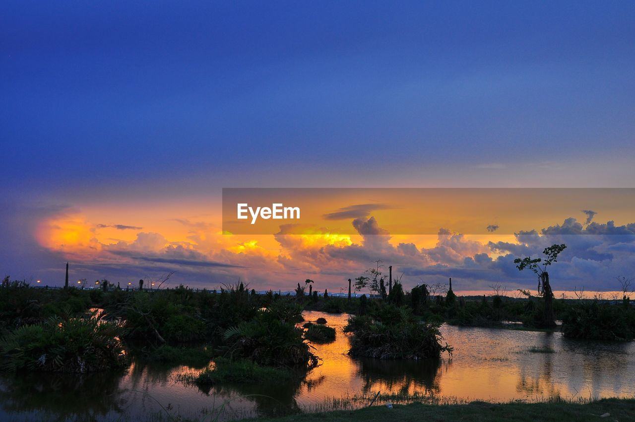sunset, sky, water, scenics, beauty in nature, nature, tranquil scene, cloud - sky, reflection, lake, tree, silhouette, tranquility, no people, outdoors, waterfront, day