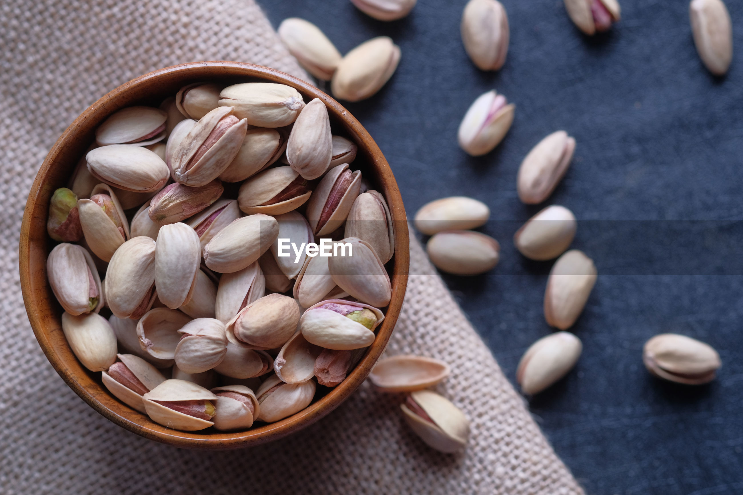 Close up of pistachios on hand, healthy eating