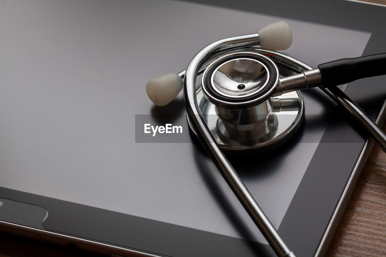 Close-Up Of Stethoscope On Digital Tablet