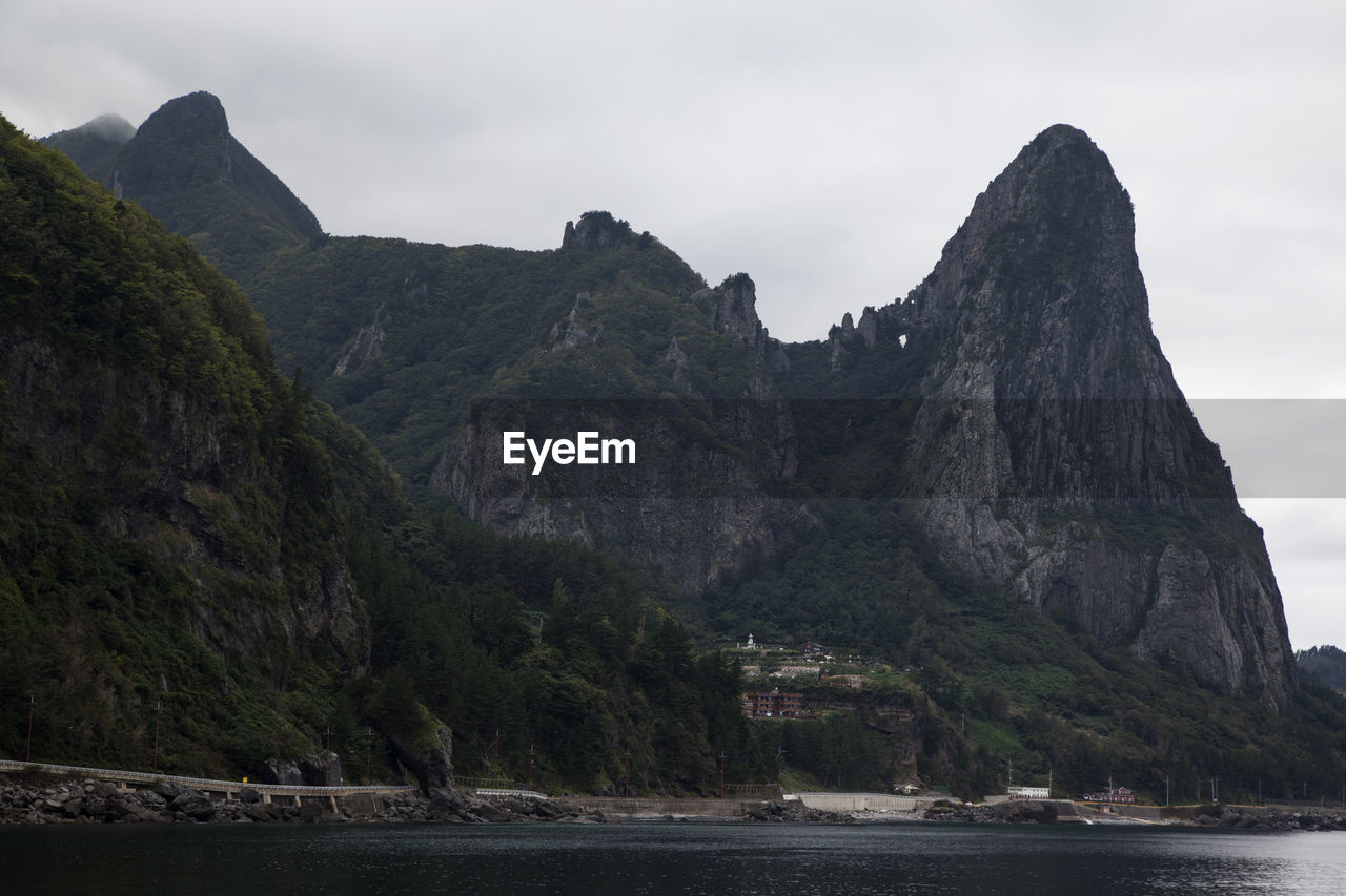 Scenic View Of Mountains By Sea At Ulleungdo Island