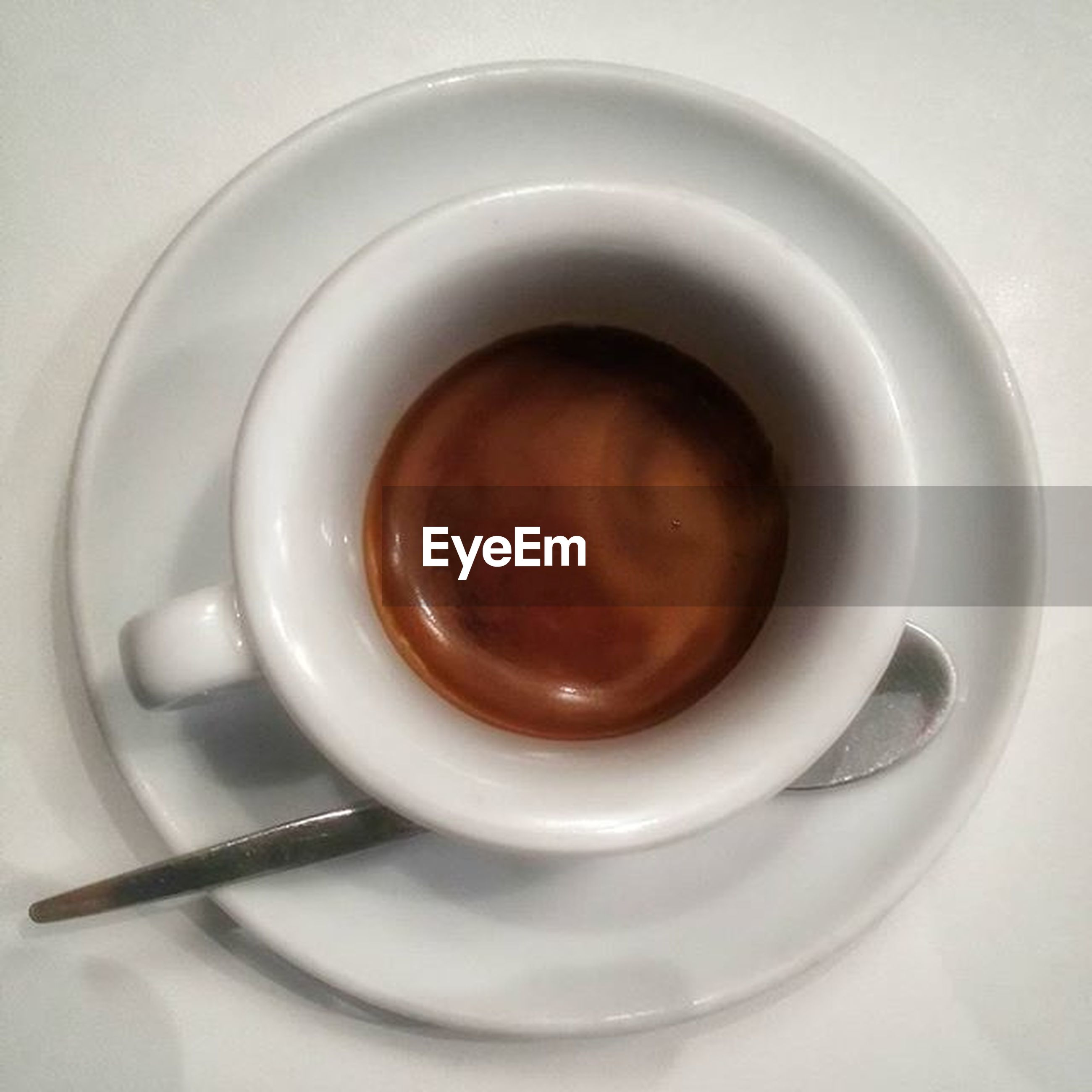 indoors, coffee cup, food and drink, drink, still life, refreshment, high angle view, directly above, table, saucer, coffee - drink, freshness, cup, spoon, coffee, close-up, white color, plate, overhead view, no people