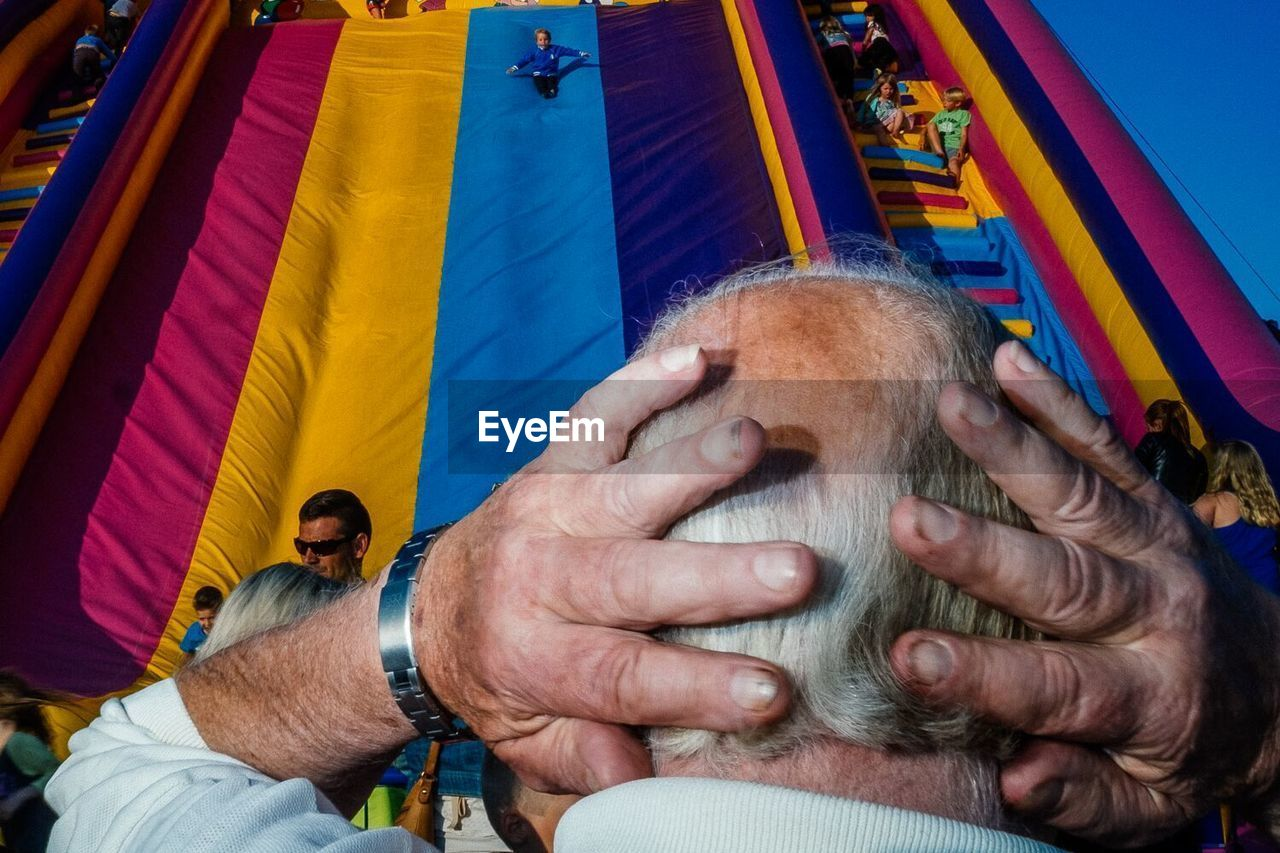 real people, men, people, human hand, emotion, hand, human body part, adult, day, incidental people, leisure activity, lifestyles, flag, focus on foreground, patriotism, arts culture and entertainment, close-up, males, human limb