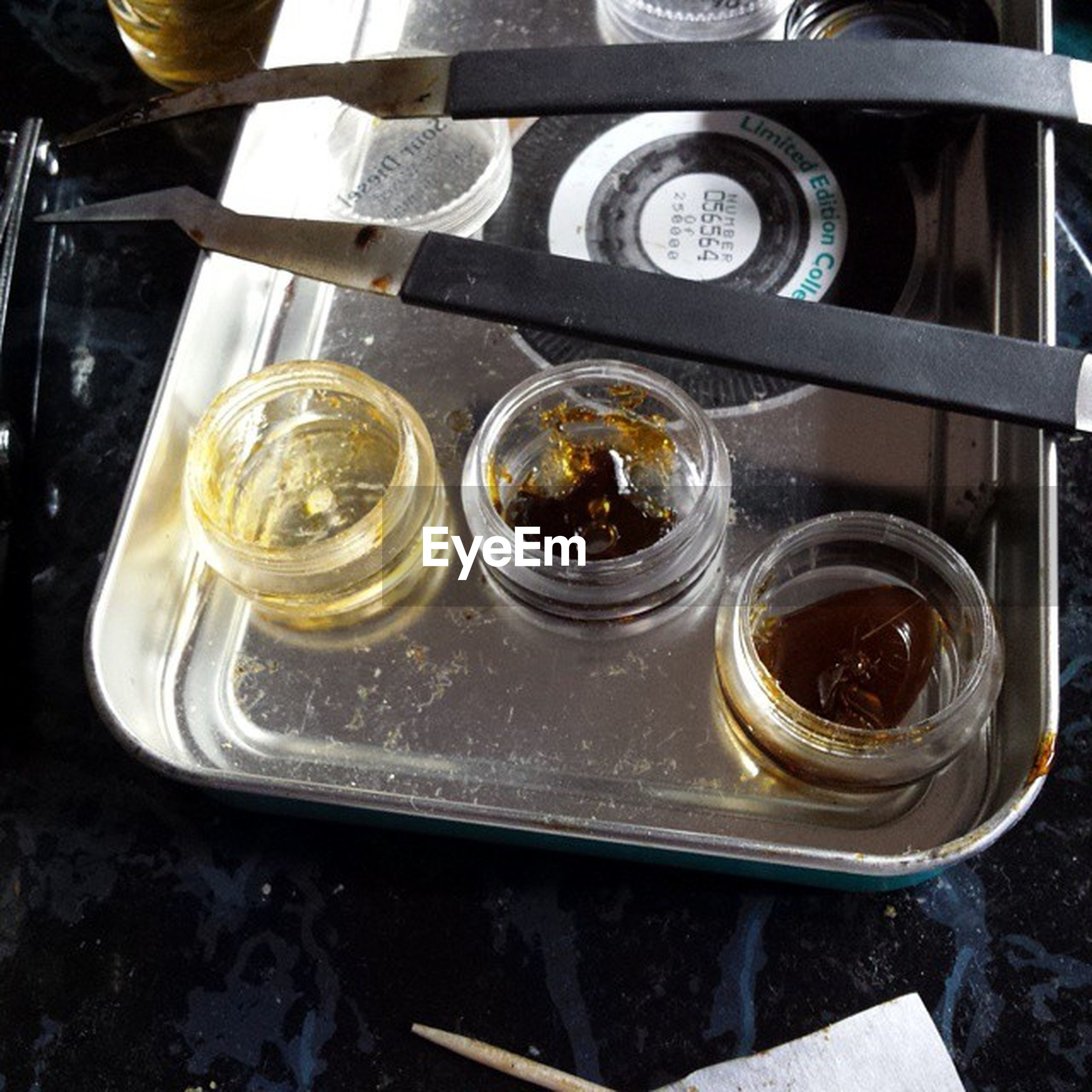 indoors, drink, reflection, glass - material, close-up, table, food and drink, still life, refreshment, metal, no people, drinking glass, water, high angle view, transparent, day, freshness, container, jar