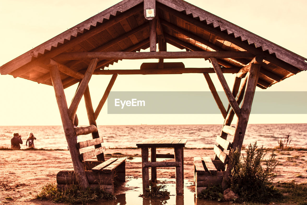 sea, water, pier, beach, wood - material, outdoors, nature, day, sand, horizon over water, clear sky, sky, architecture, no people