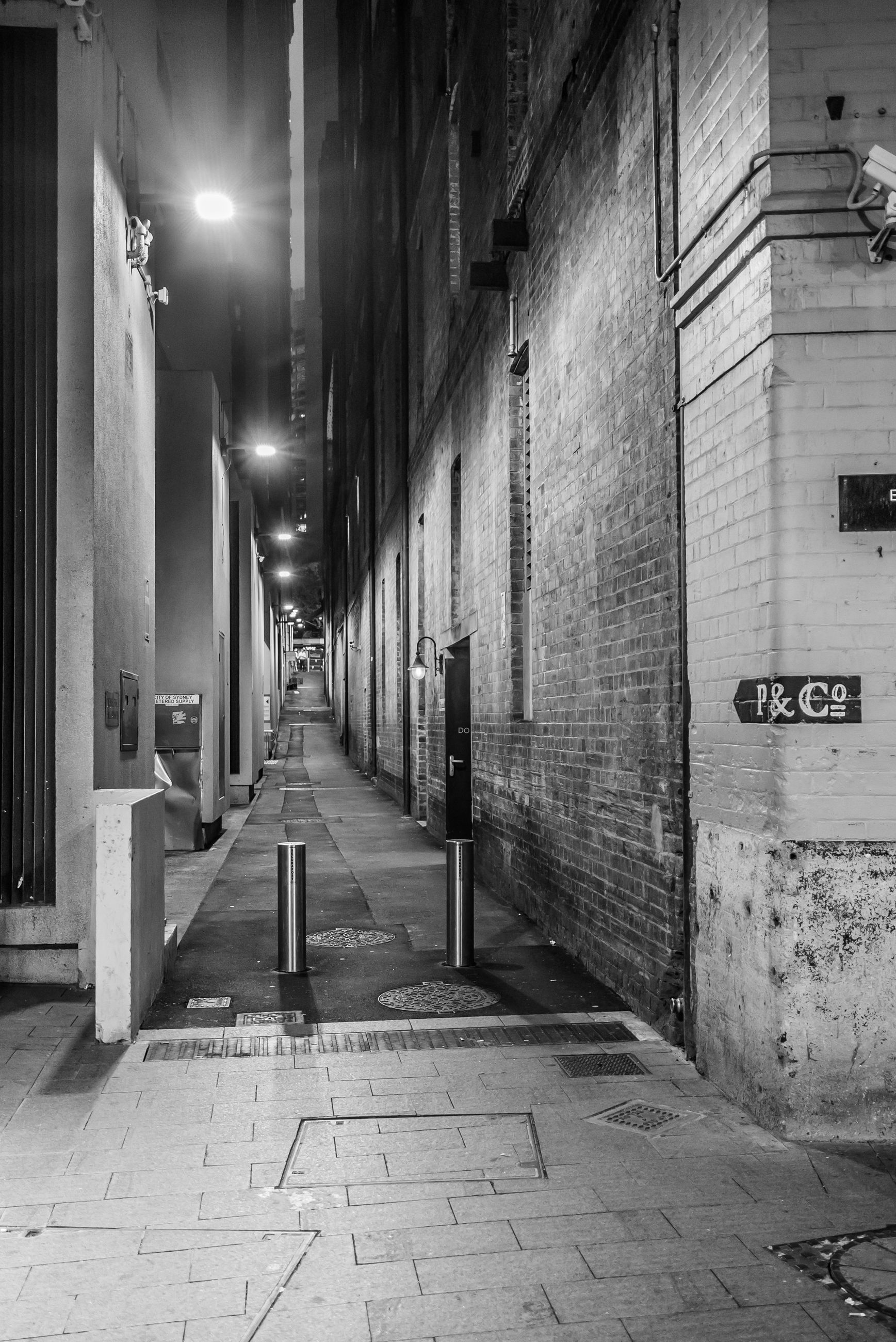 EMPTY WALKWAY IN CITY AT NIGHT