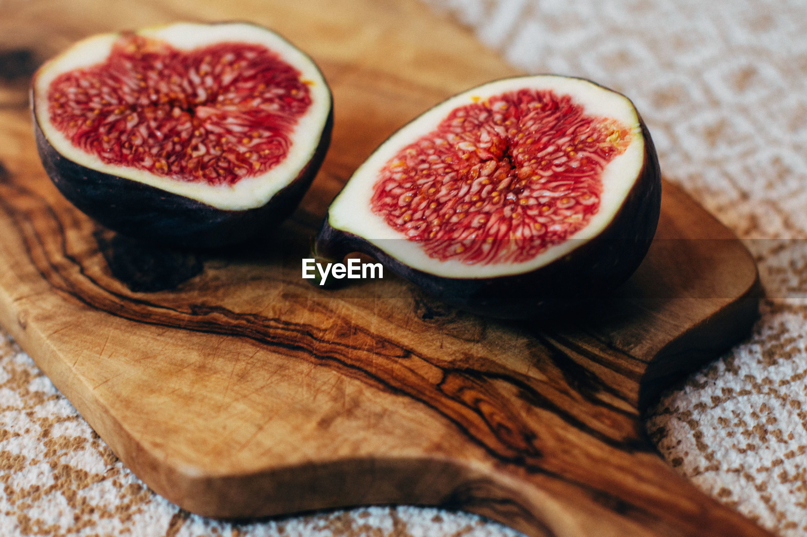Close-up of cut fig on cutting board