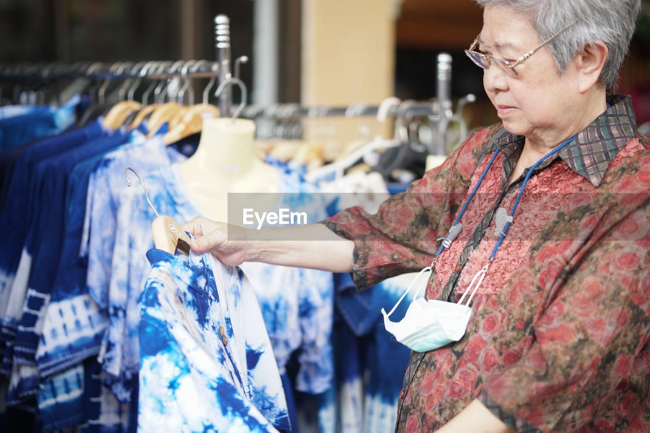 Woman holding dress at shop