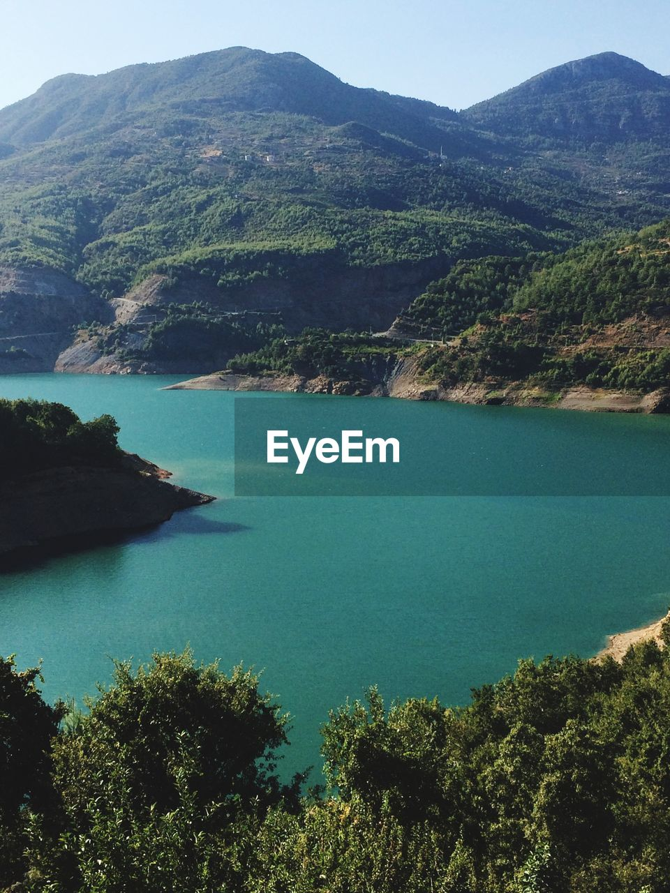 water, beauty in nature, mountain, scenics - nature, tranquil scene, tranquility, day, nature, tree, plant, lake, idyllic, no people, turquoise colored, outdoors, land, sky, mountain range, bay