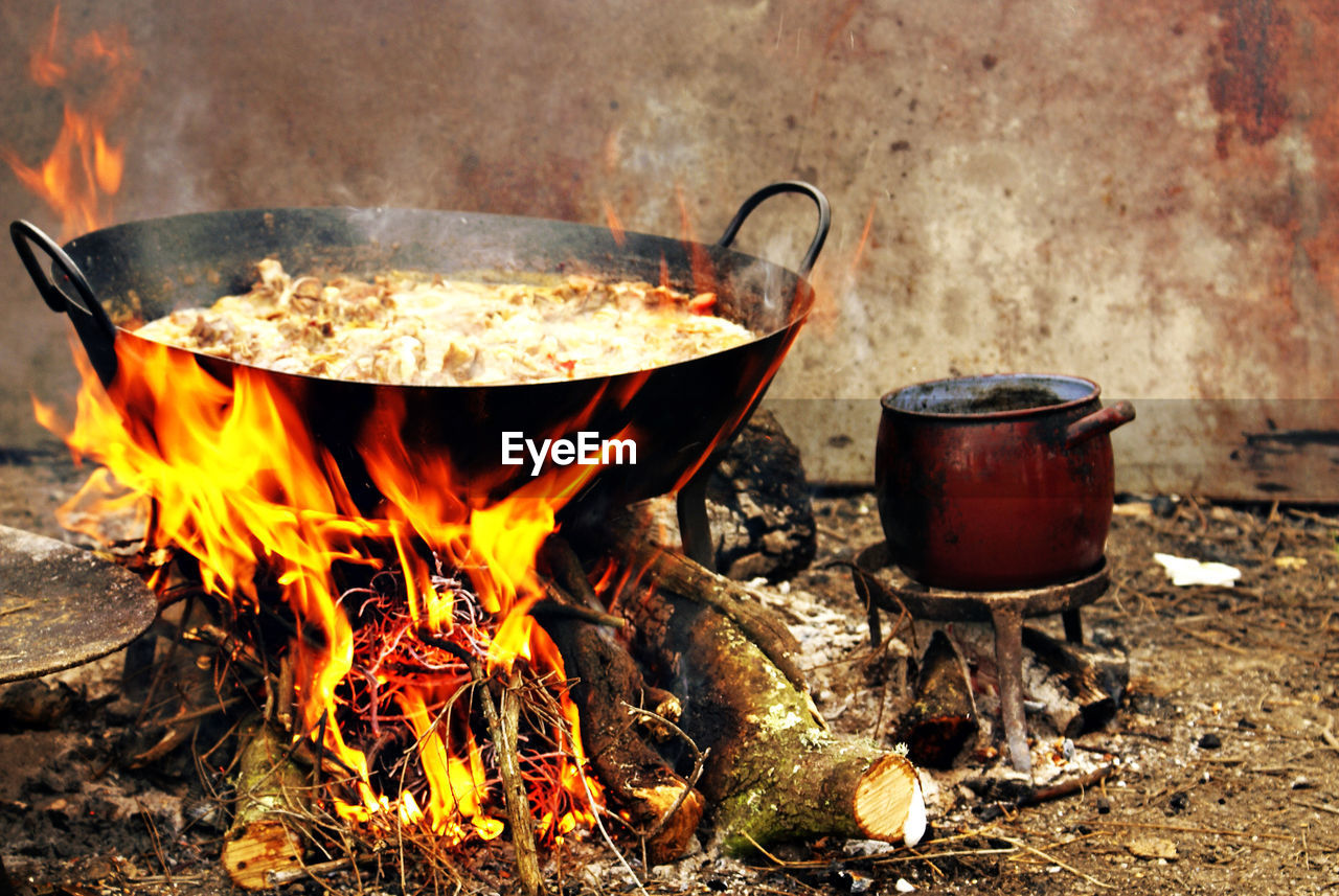 burning, fire, flame, heat - temperature, fire - natural phenomenon, kitchen utensil, household equipment, food and drink, wood - material, preparation, cooking pan, nature, food, wood burning stove, no people, stove, log, close-up, day, wood, cooking utensil, preparing food, bonfire, camping stove, skillet- cooking pan