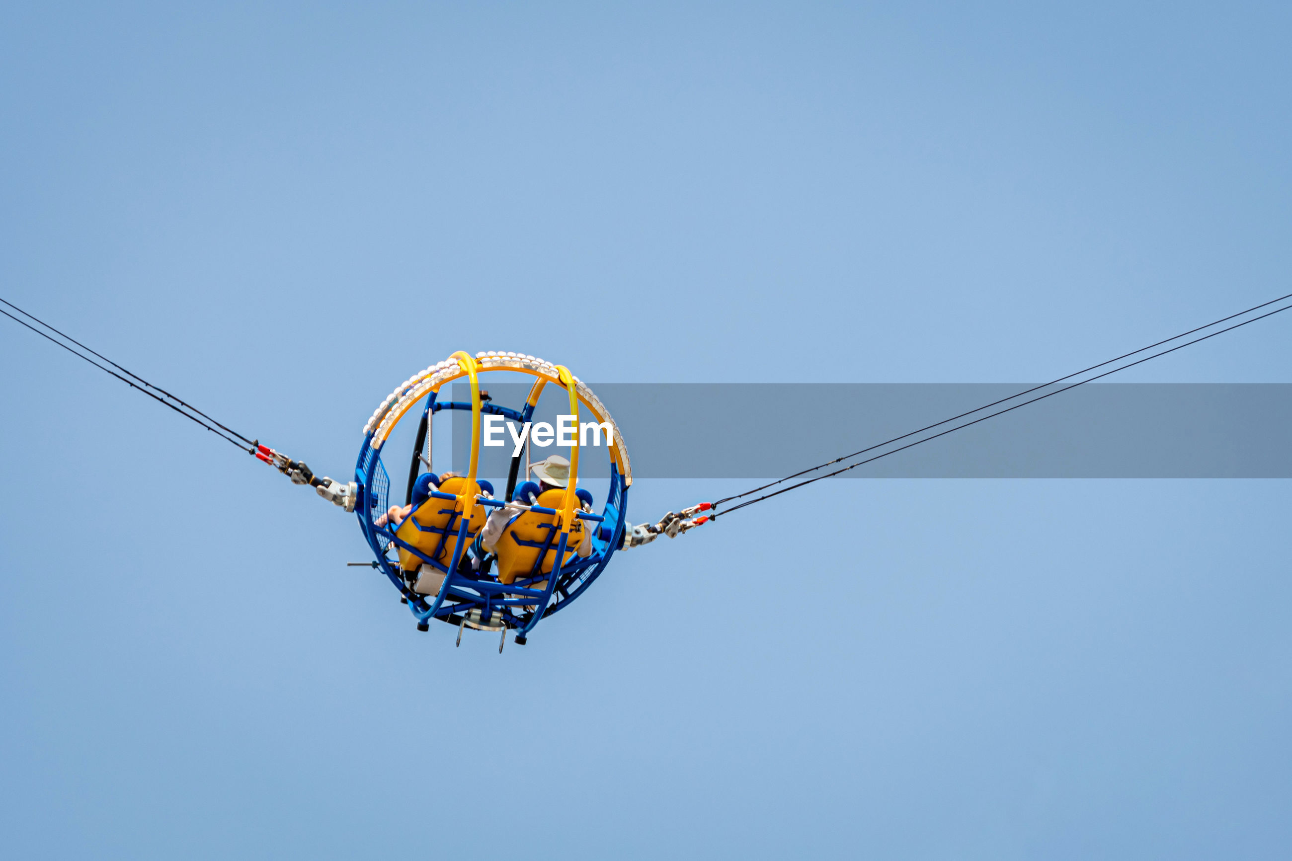 LOW ANGLE VIEW OF ROPE HANGING AGAINST CLEAR SKY