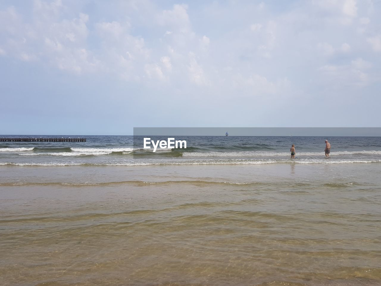 sea, water, sky, land, beach, horizon, horizon over water, beauty in nature, scenics - nature, motion, day, nature, wave, cloud - sky, real people, men, non-urban scene, people, leisure activity, outdoors