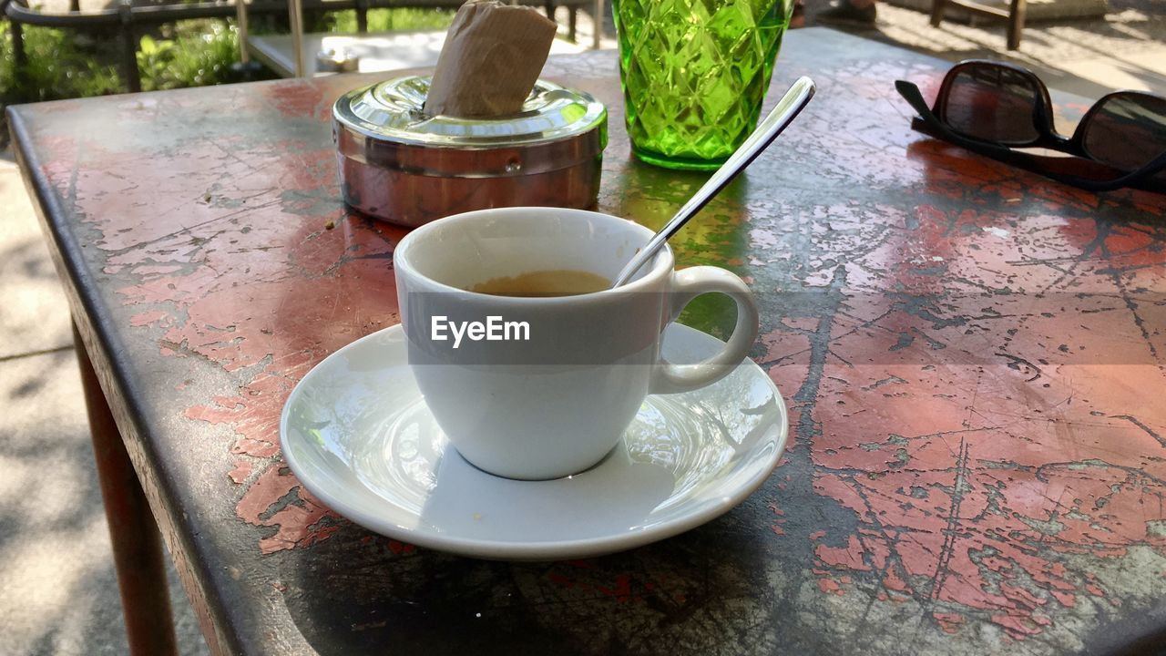 table, cup, saucer, drink, food and drink, mug, refreshment, crockery, coffee cup, still life, no people, tea, day, tea - hot drink, high angle view, close-up, coffee, hot drink, freshness, food, outdoors, tea cup, tray