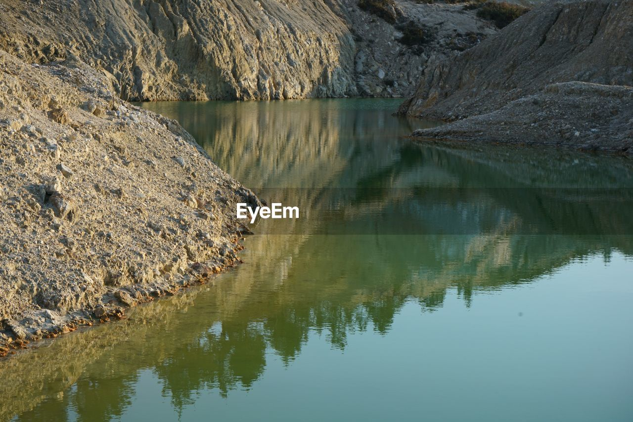 reflection, water, waterfront, lake, standing water, no people, nature, scenics, outdoors, day, beauty in nature, mountain, sky
