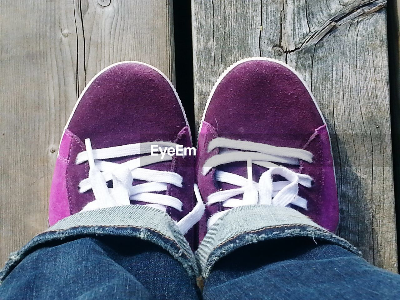 shoe, low section, one person, human leg, real people, standing, personal perspective, human body part, canvas shoe, pair, shoelace, casual clothing, lifestyles, indoors, men, close-up, day, people