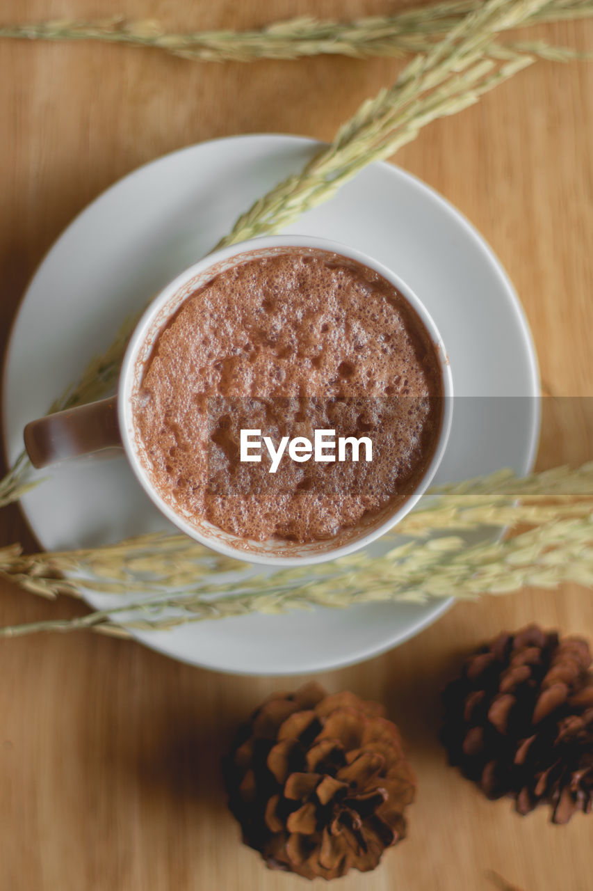 food and drink, food, table, indoors, still life, close-up, freshness, no people, bowl, drink, high angle view, refreshment, wood - material, wellbeing, focus on foreground, brown, ready-to-eat, healthy eating, cup, spoon, temptation