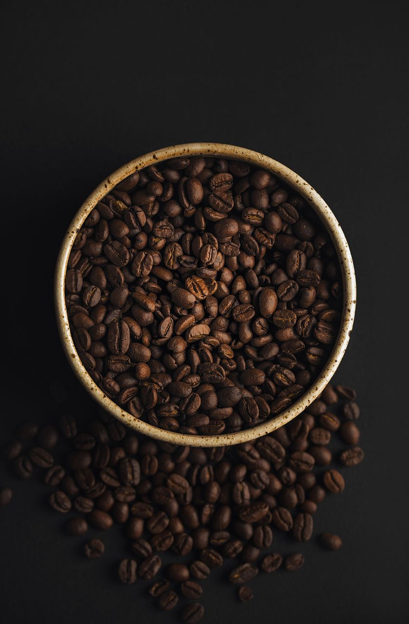 coffee, coffee - drink, indoors, food and drink, still life, roasted coffee bean, freshness, studio shot, brown, food, no people, large group of objects, directly above, close-up, coffee bean, abundance, black background, table, high angle view, drink, caffeine